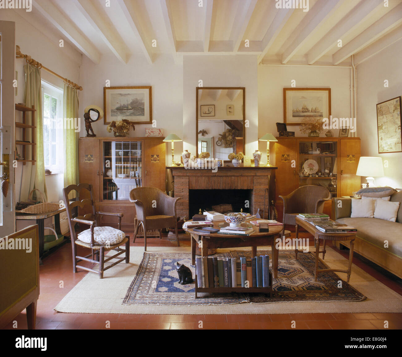 Lloyd Loom chairs and comfortable sofa in French country living ...