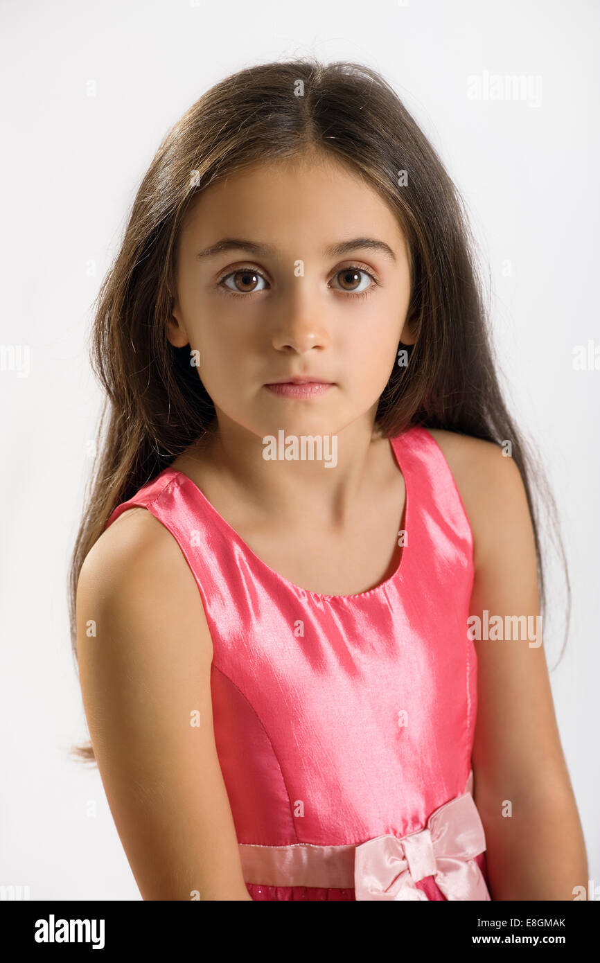 pretty little girl in a stylish pink dress and sash. Black Bedroom Furniture Sets. Home Design Ideas