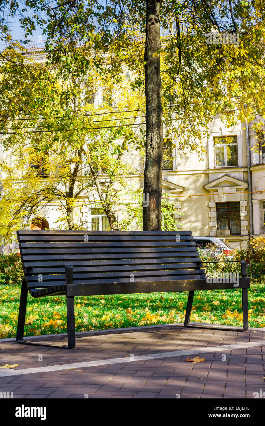 lonely brown wooden bench in a quiet city park on a background of ... for Park Background With Bench  54lyp