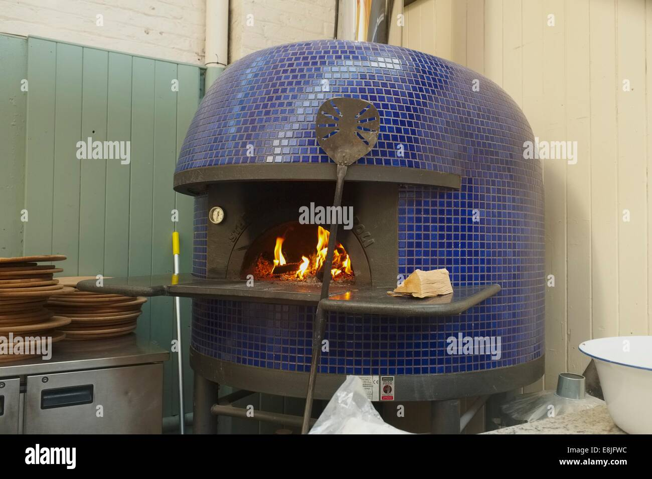 lighting a traditional italian wood fired pizza oven in the stock
