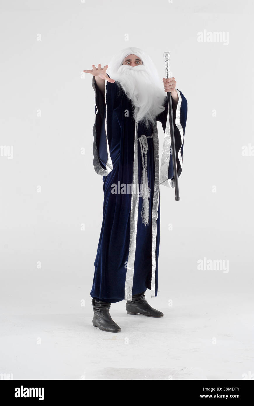 man in fancy dress comedy costume as a moses god like figure or
