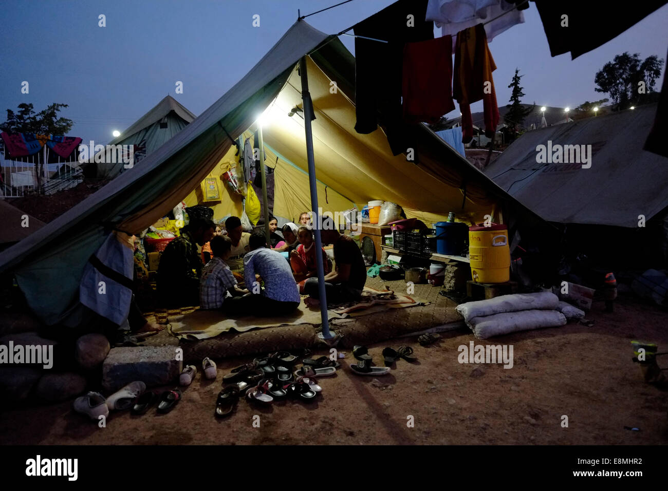 A Yazidi family eating inside a temporary shelter tent at a Yazidi refugee c& in the town of Zakho Northern Iraq. Displaced people from the minority ... & A Yazidi family eating inside a temporary shelter tent at a Yazidi ...