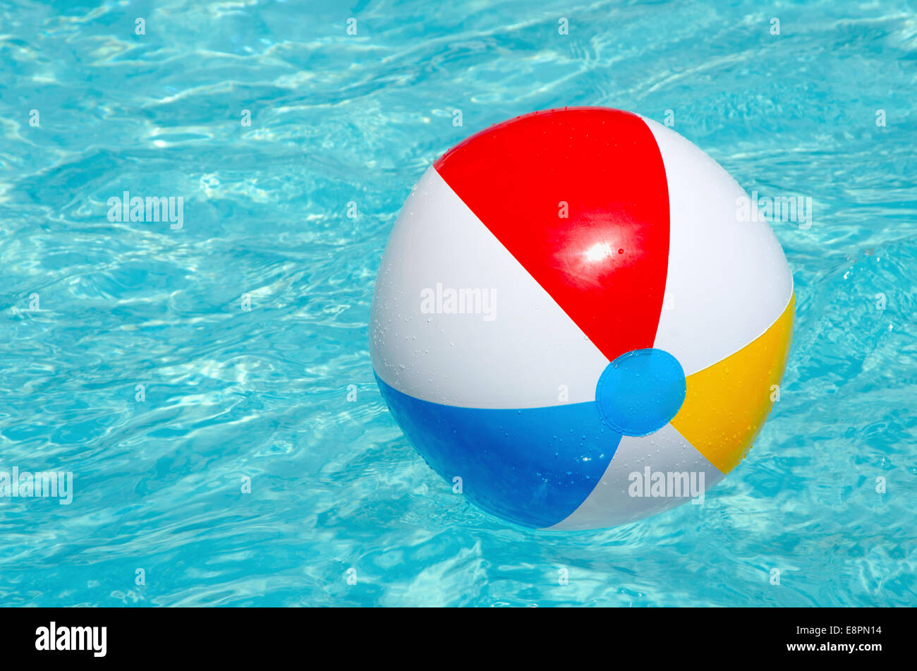 pool water with beach ball. A Colorful Beach Ball In Swimming Pool Surrounded By Aqua Marine Water. Perfect Image For Any Summer Project Water With