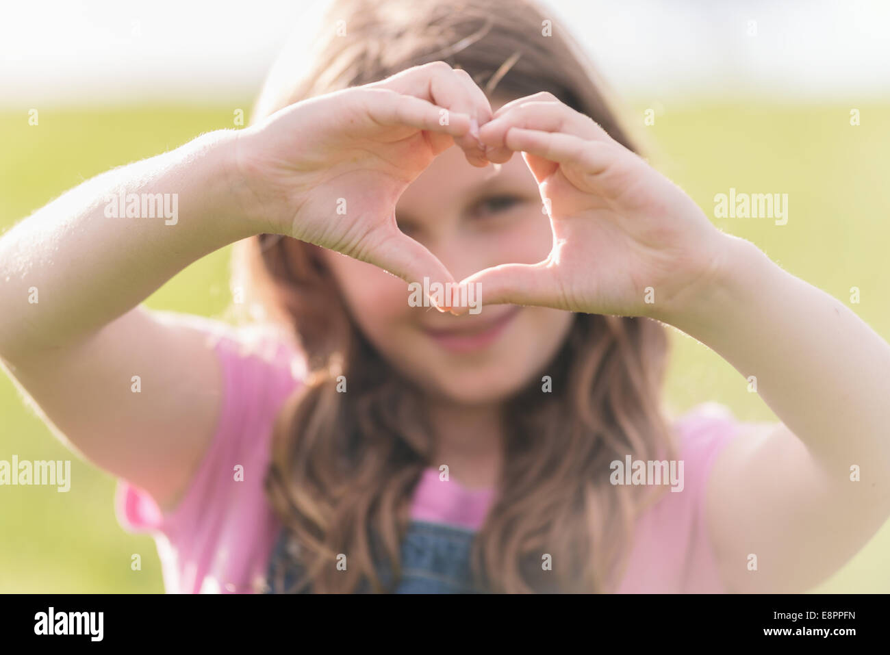 girl making a heart shape with her hands Stock Photo: 74259353 - Alamy