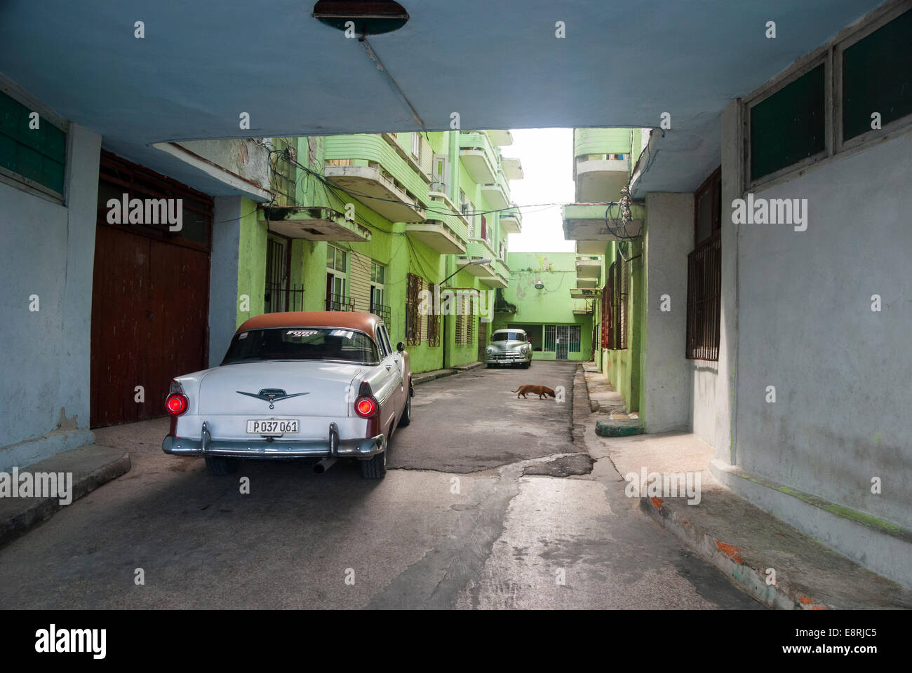 An Old Ford Fairlane At The Back Alley Entrance To An Apartment Building In  Central Havana Cuba