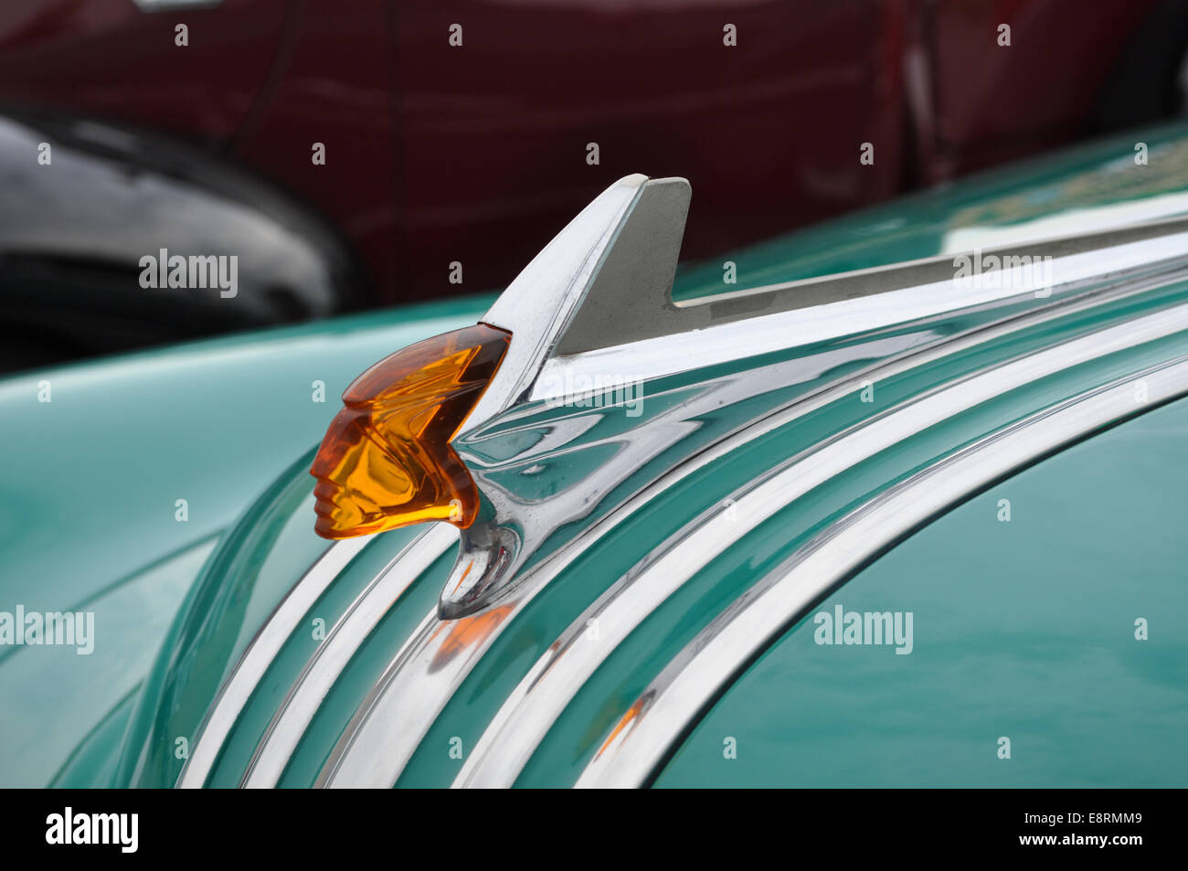 Wing hood ornament - A Hood Ornament On A 1952 Pontiac Chieftain Stock Image