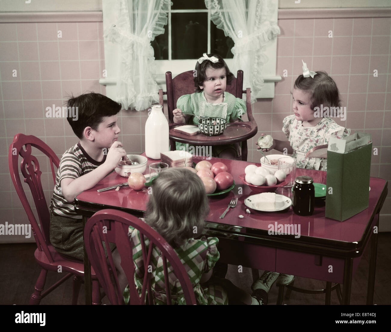 1940s 1950s boy and girls eating breakfast at kitchen table food cereal bread milk eggs apples 1940s 1950s boy and girls eating breakfast at kitchen table food      rh   alamy com