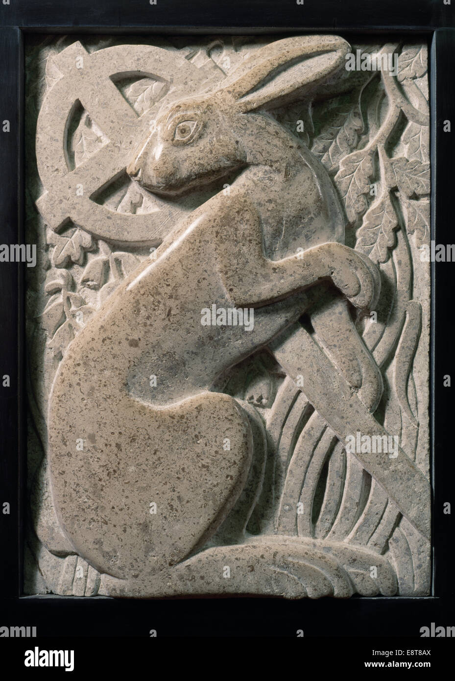 Modern stone carving of hare with celtic cross oak