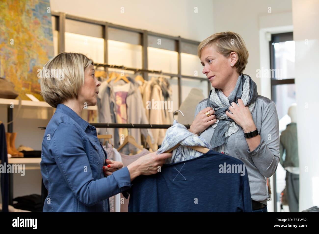 shop assistant is serving a customer stock photo royalty shop assistant is serving a customer
