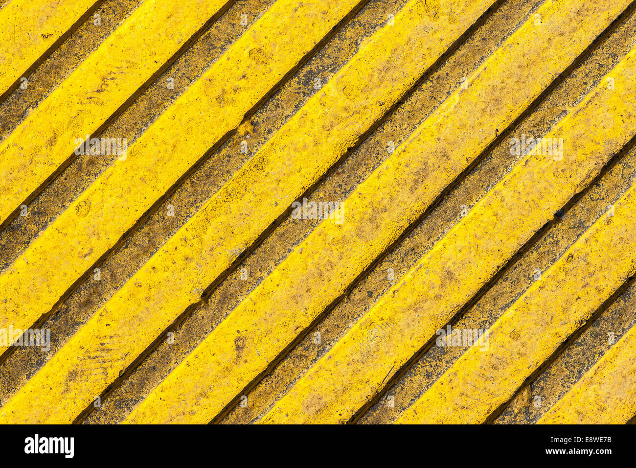 Tactile paving slab texture a paving tile of yellow color with tactile paving slab texture a paving tile of yellow color with raised diagonal lines dailygadgetfo Image collections