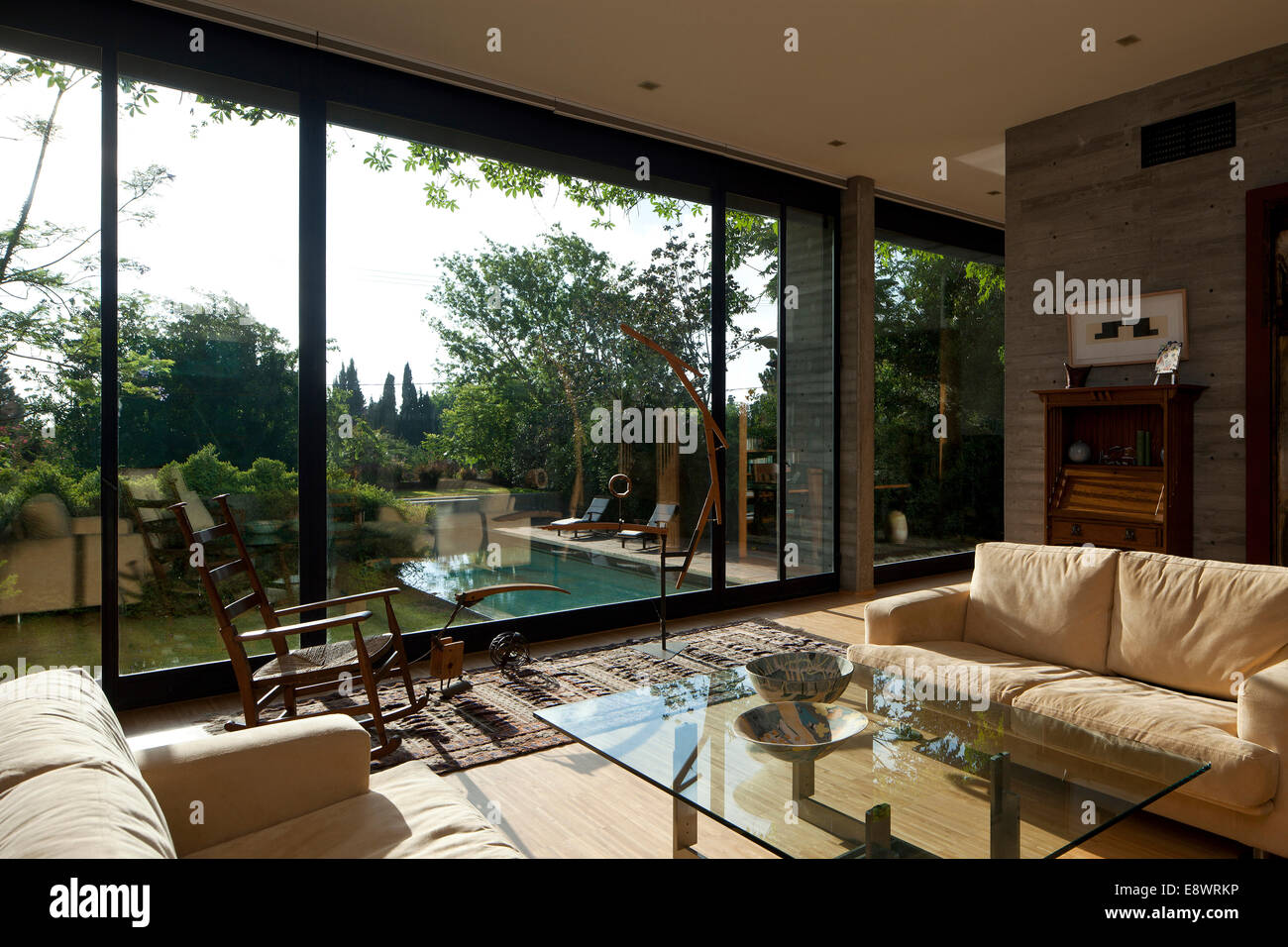 Cream Sofas And Glass Topped Coffee Table With Full Length Windows In Living Room Of Gotesman House Israel Middle East