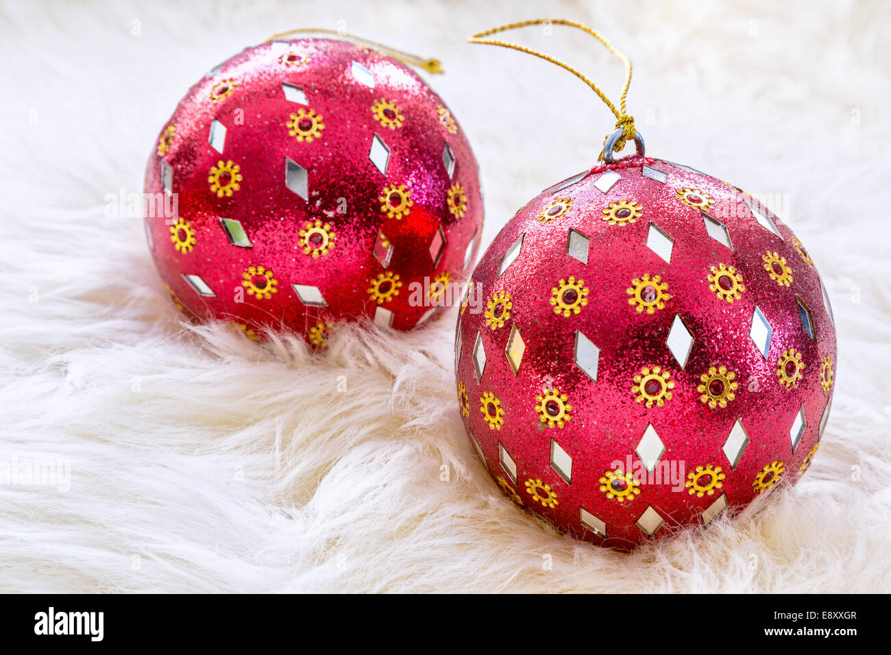 Red glass christmas ornaments - Red Glass Christmas Ornaments In A Background Of Soft White Fur