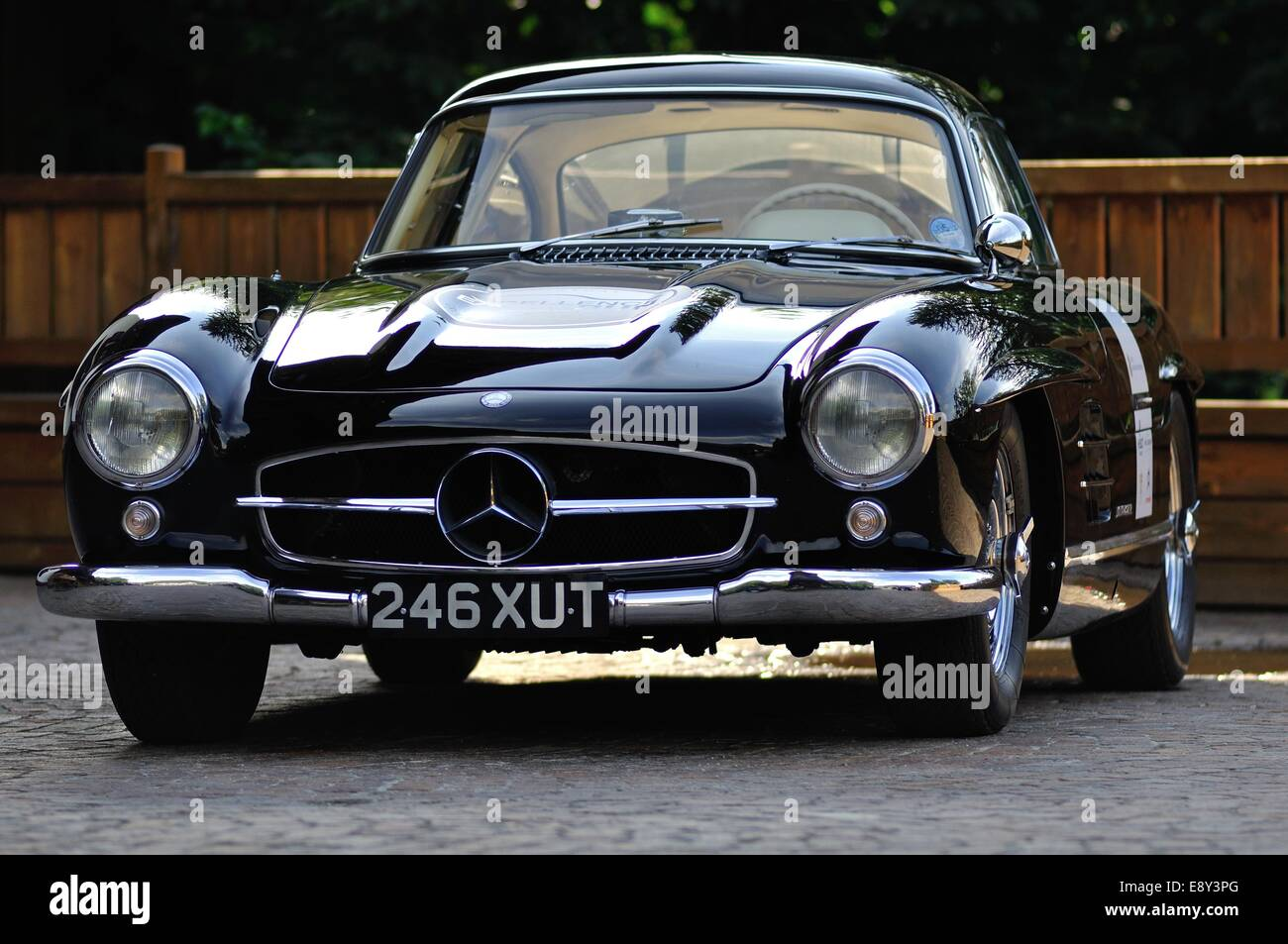 Mercedes benz 300 sl gullwing in the evening light parked by a wooden fence stock