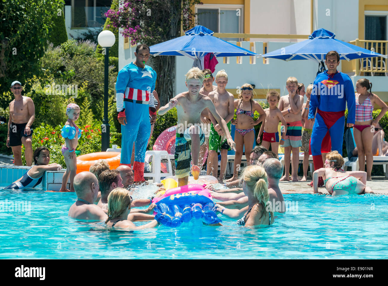 Holiday Entertainers And Kids Playing A Game In A Swimming Pool Stock Photo Royalty Free Image