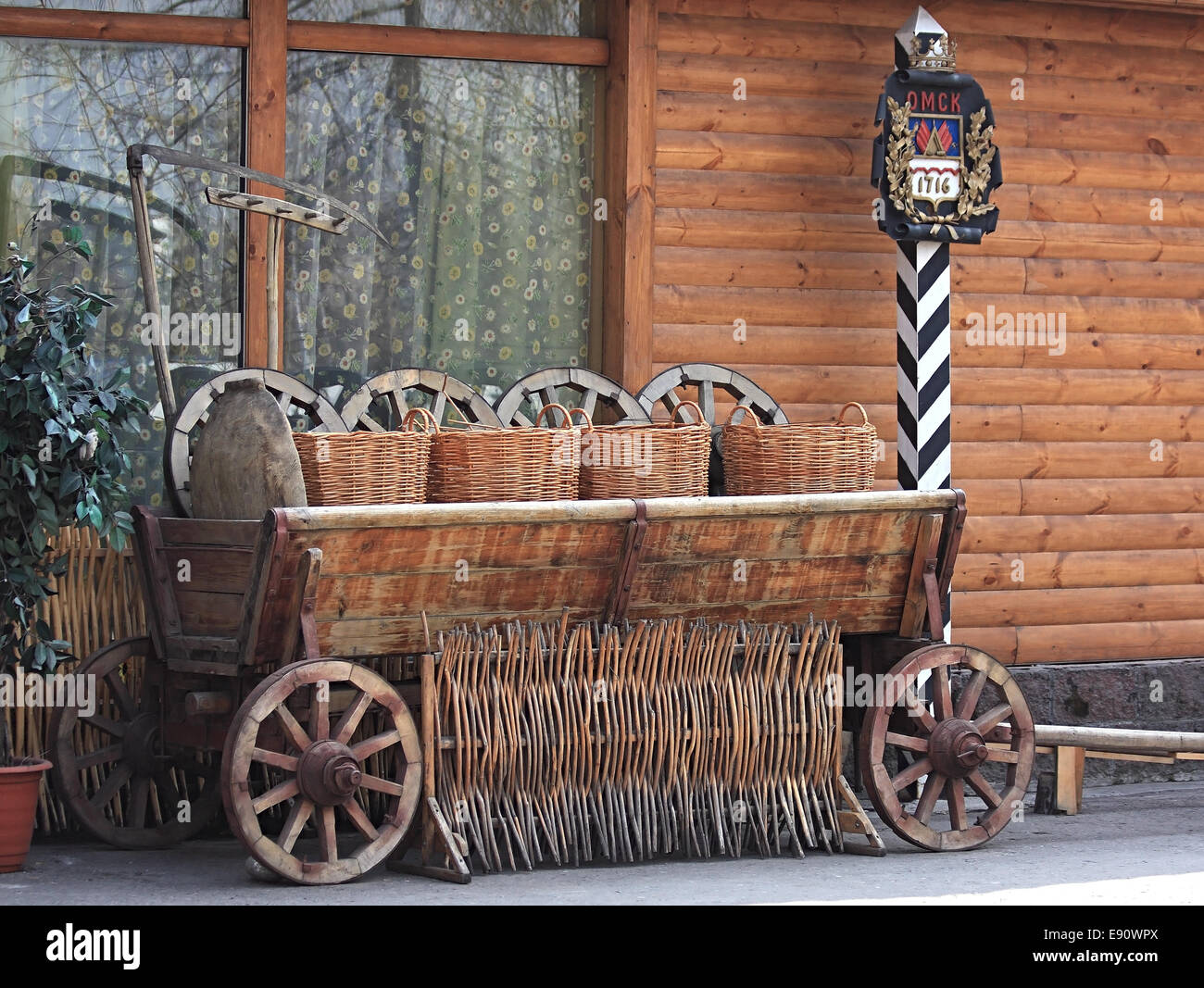 Age-old Russian Cart And Boundary Post Stock Photo