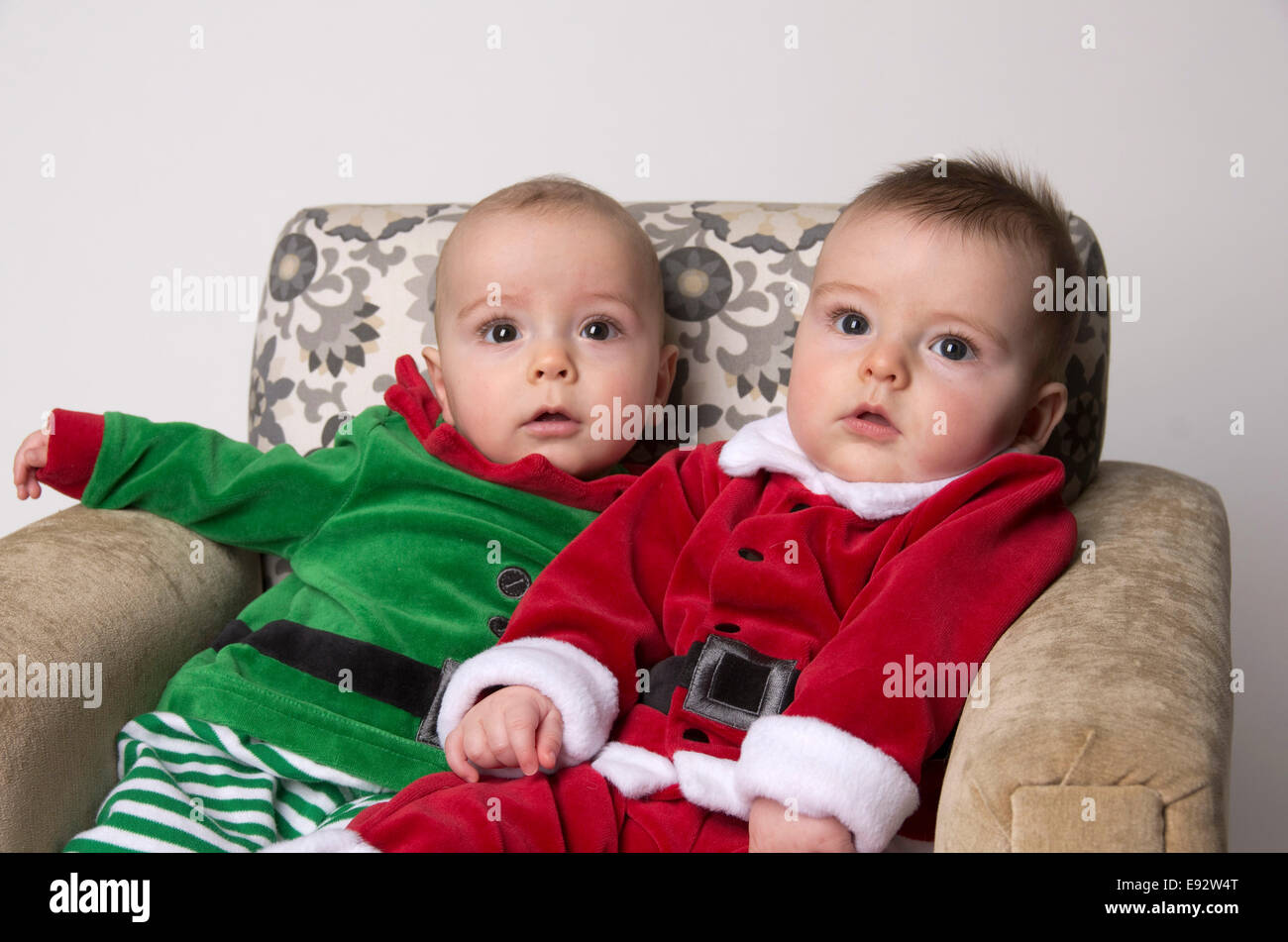fraternal twin 9 month old baby boys wearing a santa and ...