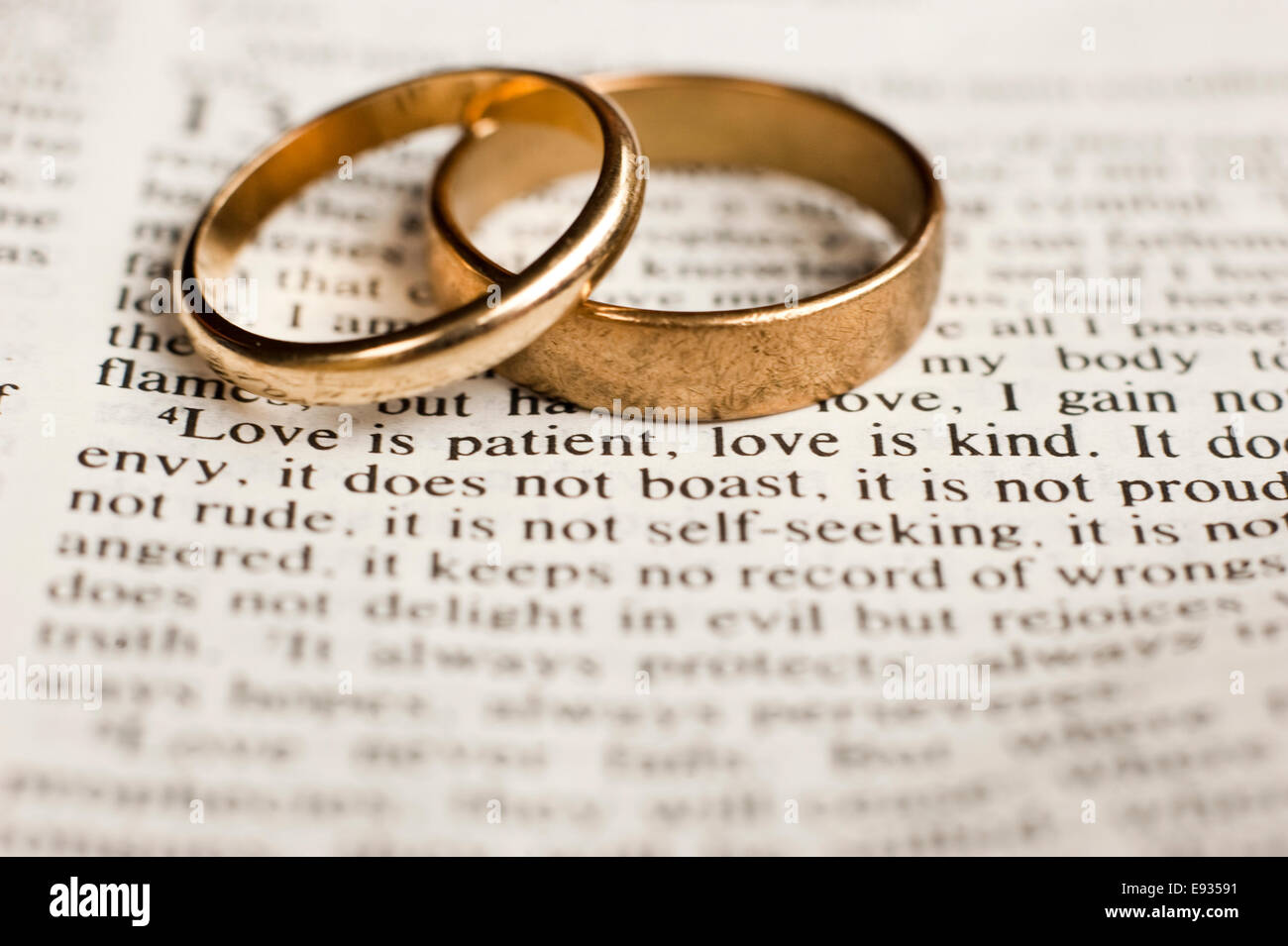 Wedding rings on bible passage on love stock photo for Wedding ring meaning bible