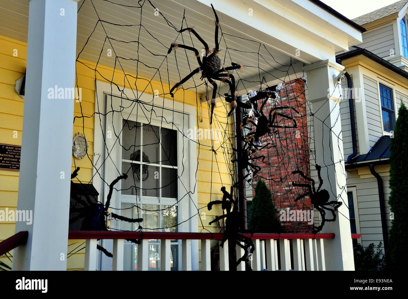 cold spring ny halloween spider decorations hang from the porch of a 19th century home on main street in the lower village