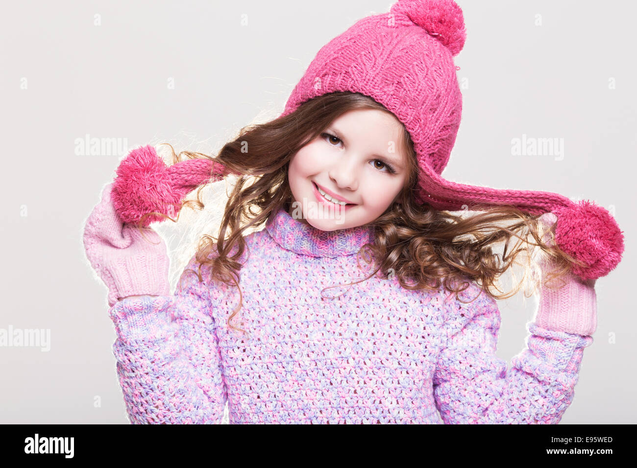 Happy little child in winter clothes cute baby girl in