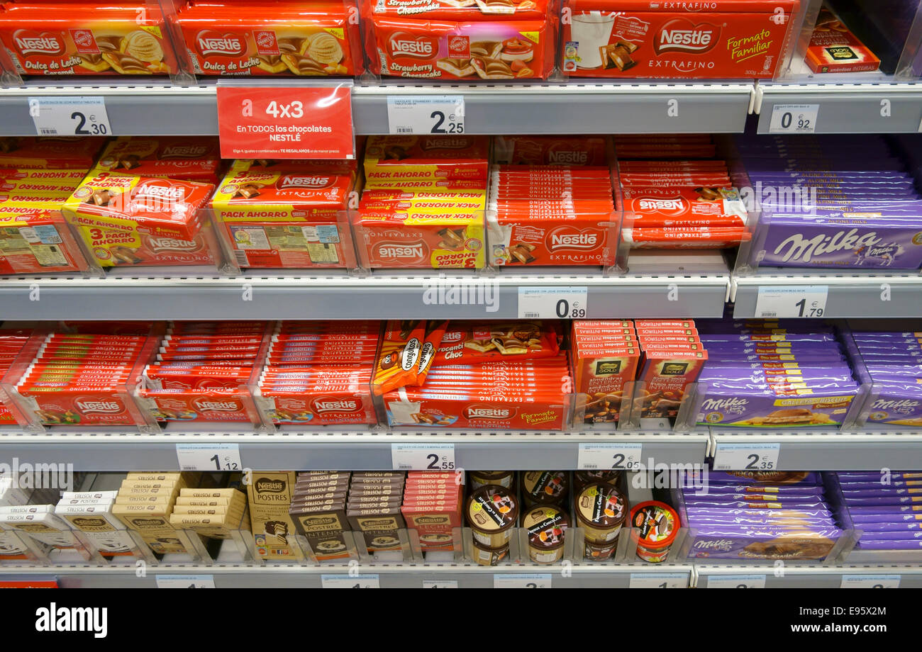 A display of different brands of chocolate a supermarket in Spain ...
