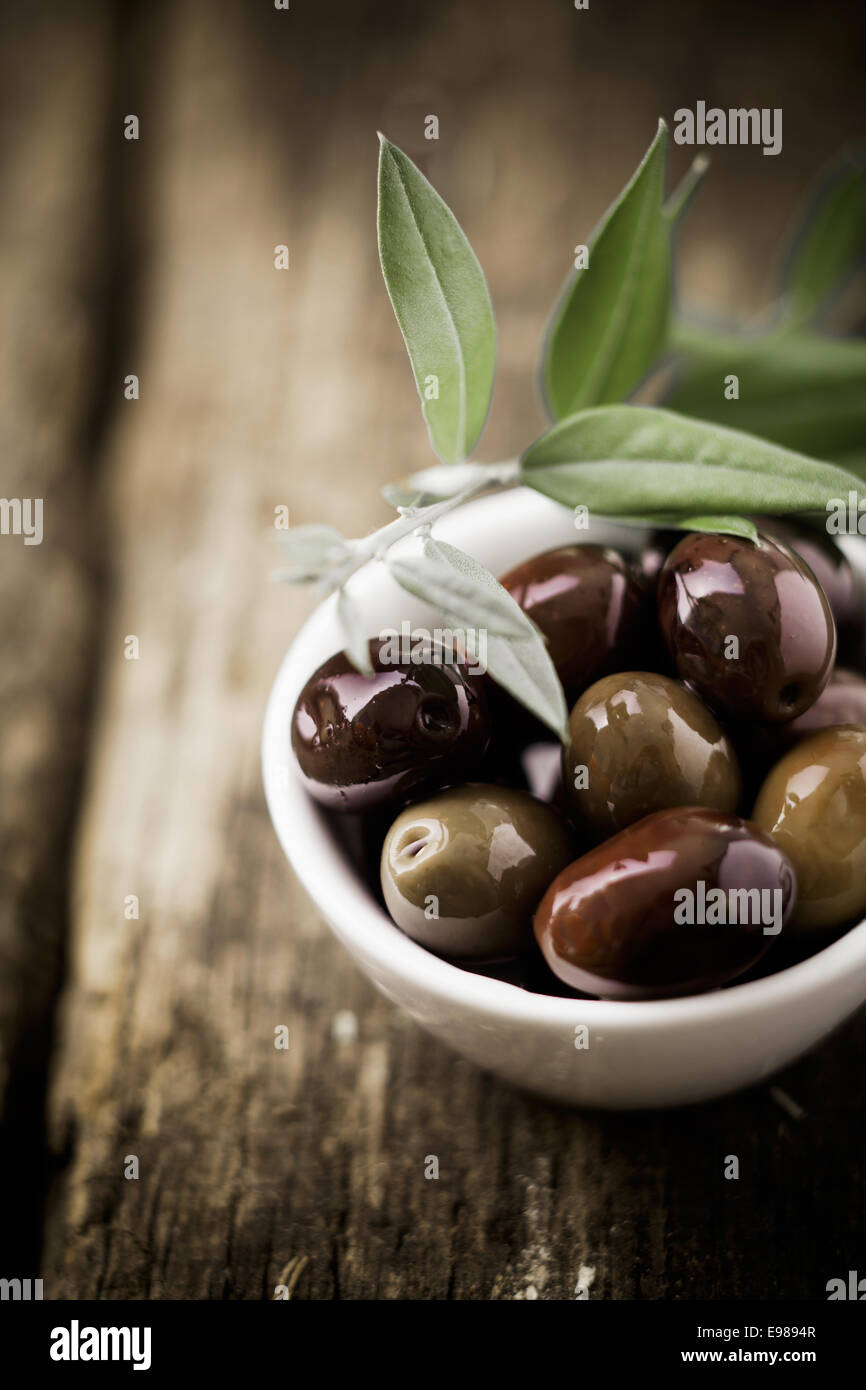 fresh black olives in a bowl for appetizers to be served with