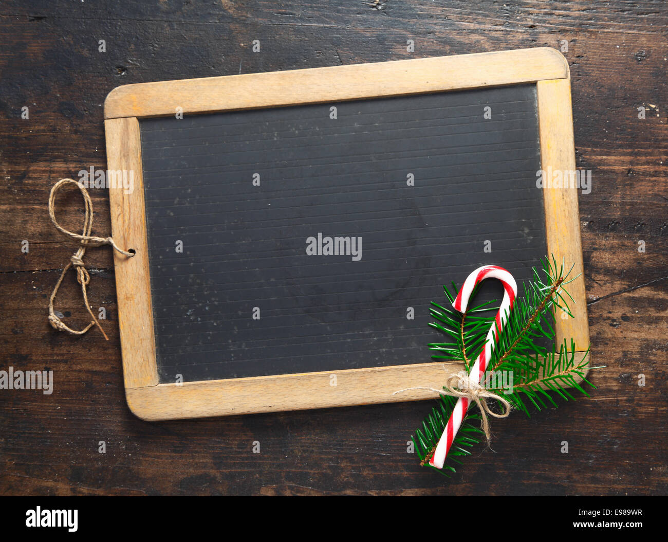 small blank wooden framed chalkboard with a festive candy cane and greenery for your seasonal message for christmas or new year - Wood Framed Chalkboard