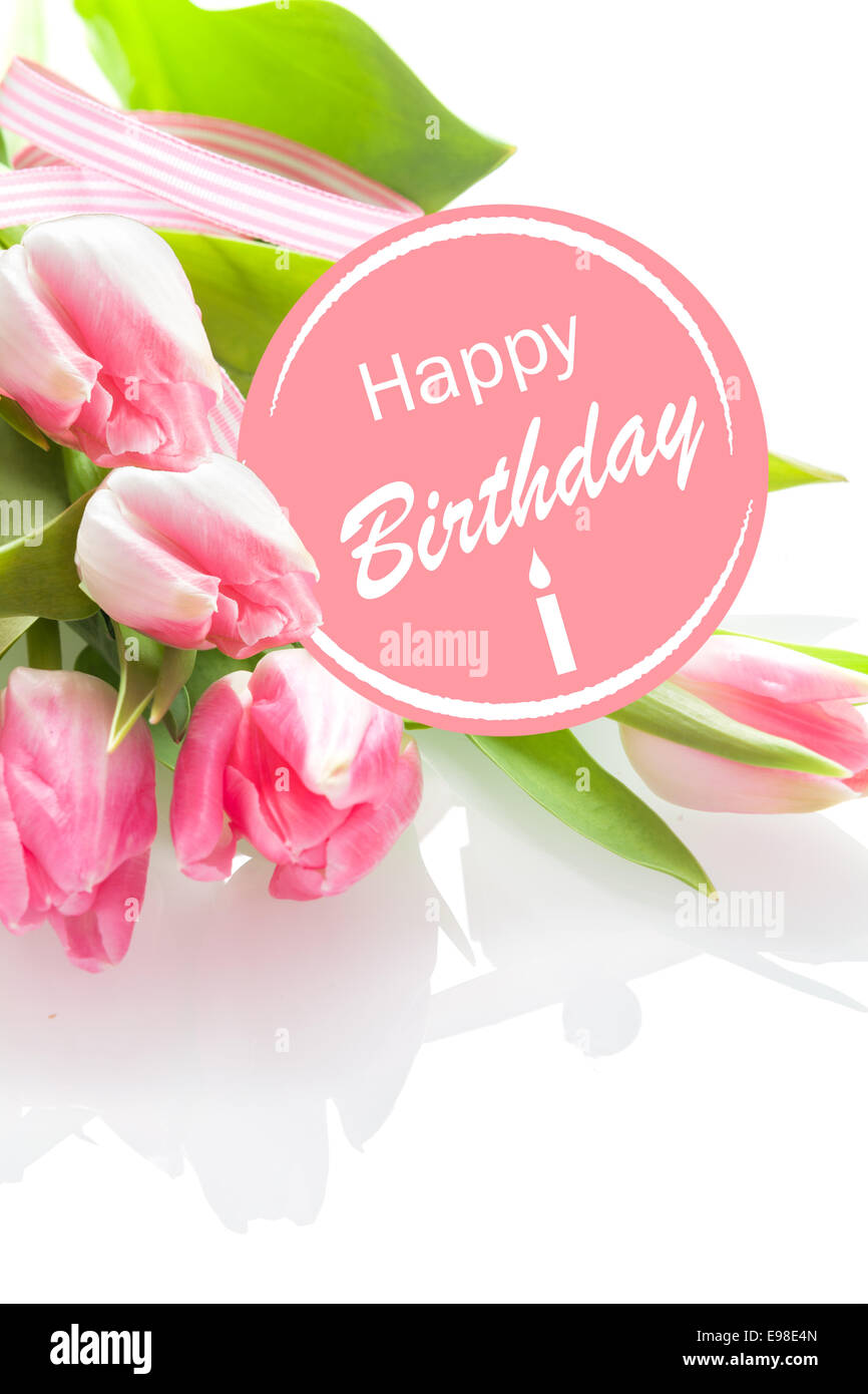 Pretty feminine happy birthday greeting with a festive pink pretty feminine happy birthday greeting with a festive pink rosette and a bouquet of beautiful fresh pink tulips on a white background closeup perspective kristyandbryce Image collections