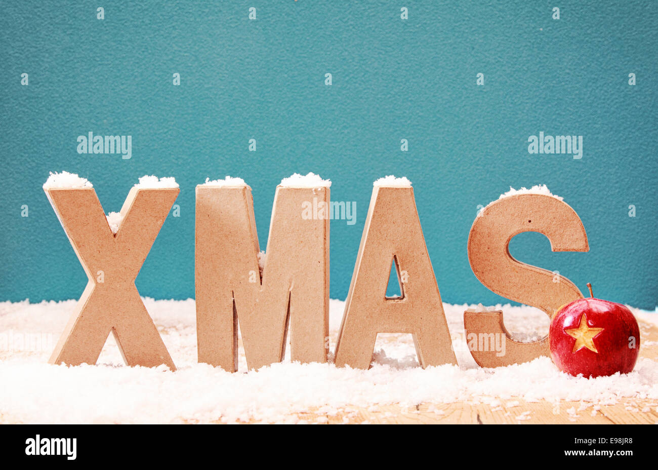 Xmas snow background with alphabet letters covered in a dusting of xmas snow background with alphabet letters covered in a dusting of snow against a cool blue winter background with a colorful red bauble decorated with a madrichimfo Images