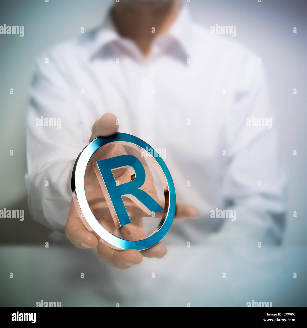 Registered trademark symbol stock photos registered trademark man holding metallic registered trademark symbol concept image for illustration of intellectual property or protection biocorpaavc Gallery