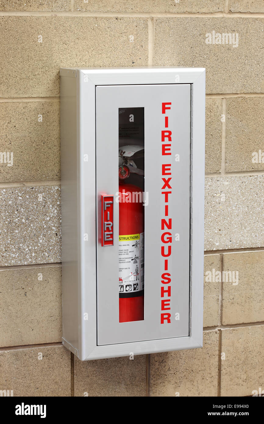 A Fire Extinguisher In A Wall Mounted Storage Box