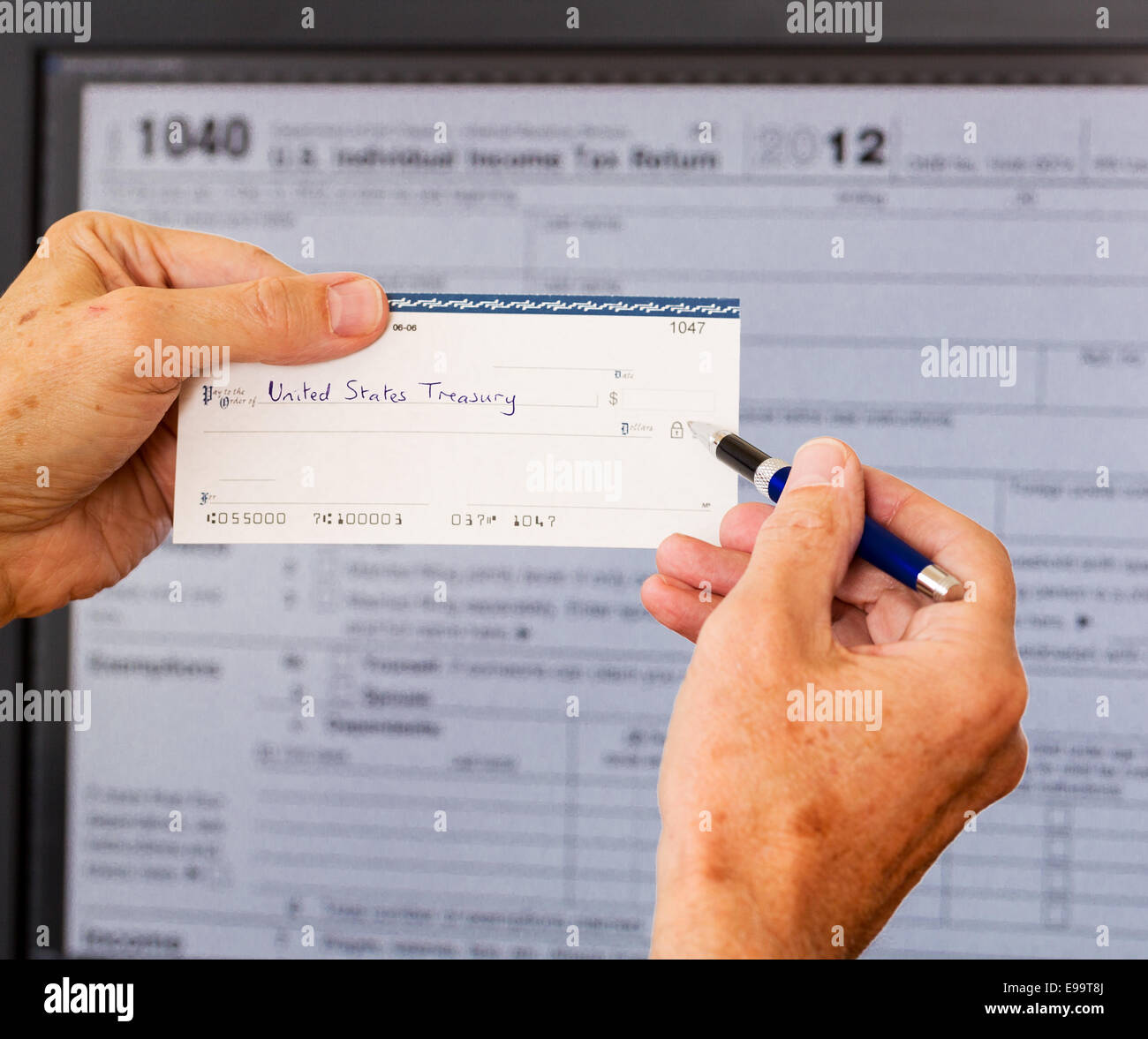 Usa tax form 1040 for year 2012 and check stock photo 74590002 alamy usa tax form 1040 for year 2012 and check falaconquin