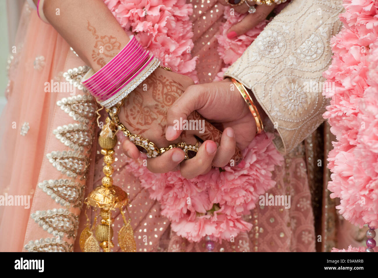 indian hindu wedding with garlands of flowers beauty colours and