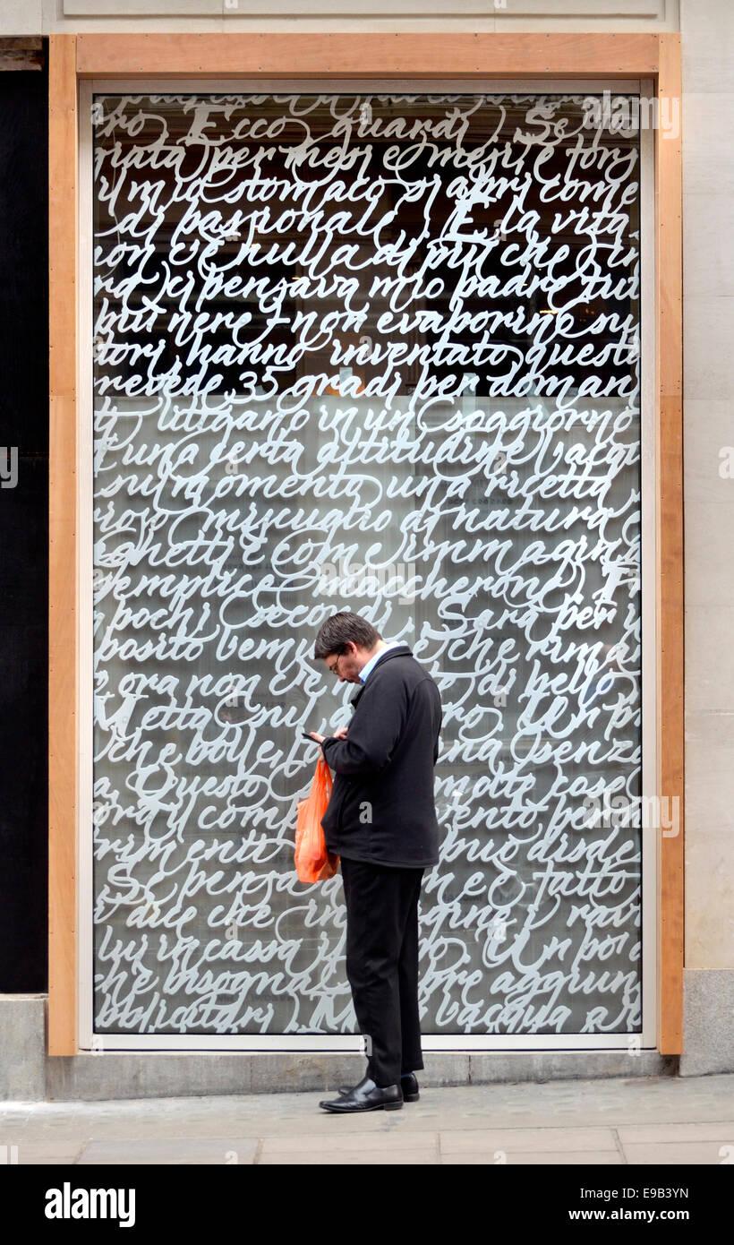 London_England_UK_Man_texting_-_concept_