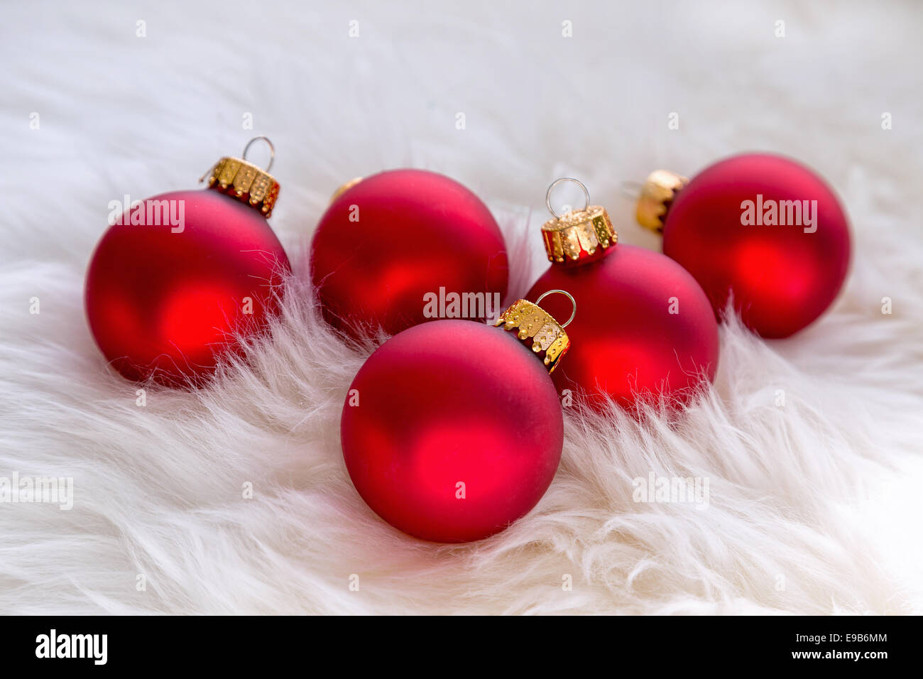 Red glass christmas ornaments in a background of soft