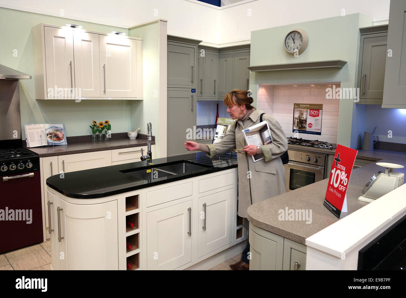 New For Kitchens Woman Shopping Looking At New Kitchen Kitchens At Wickes Uk Stock