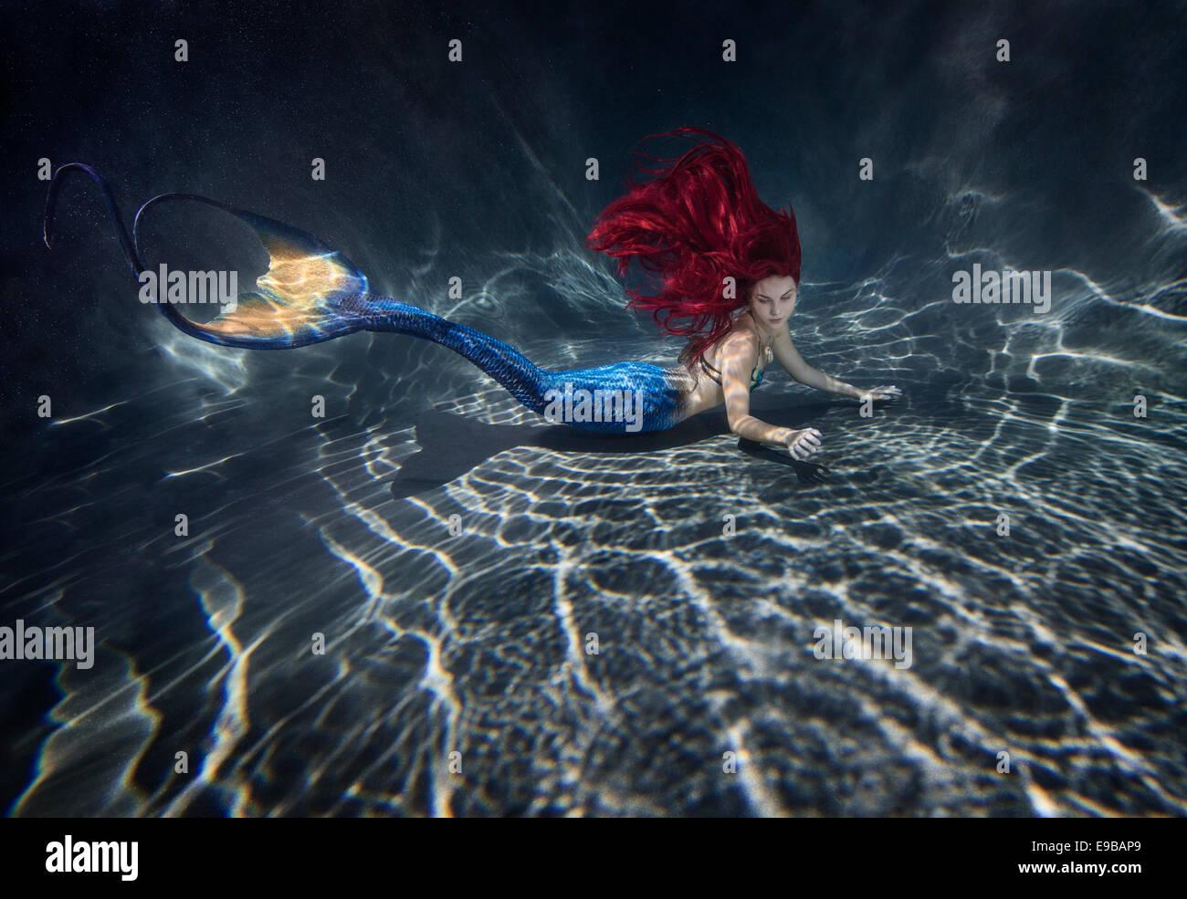 Redhead Mermaid Swimming In A Pool In Virginia Beach Virginia Stock Photo Royalty Free Image