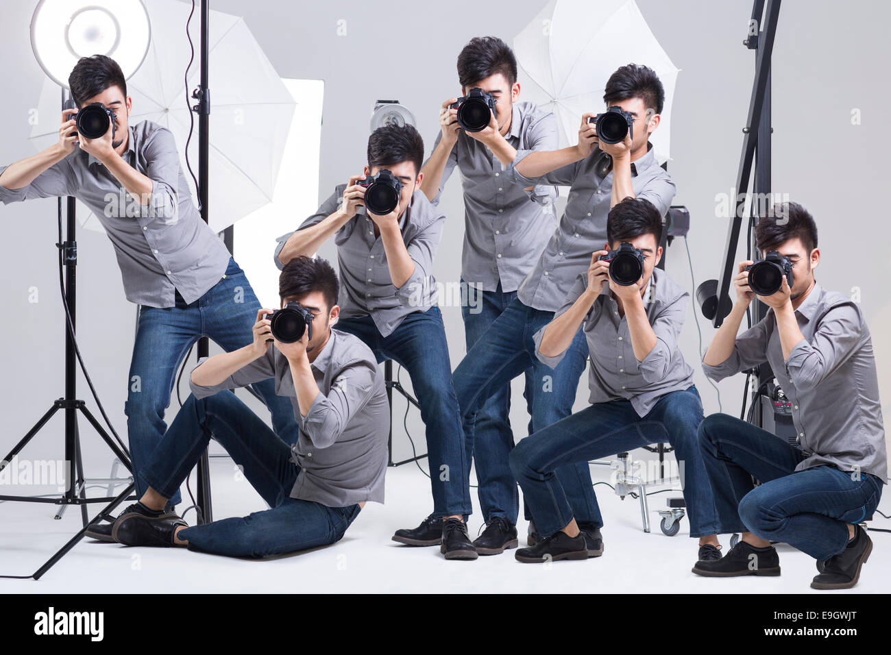 Multiple images of photographer taking picture in studio Stock