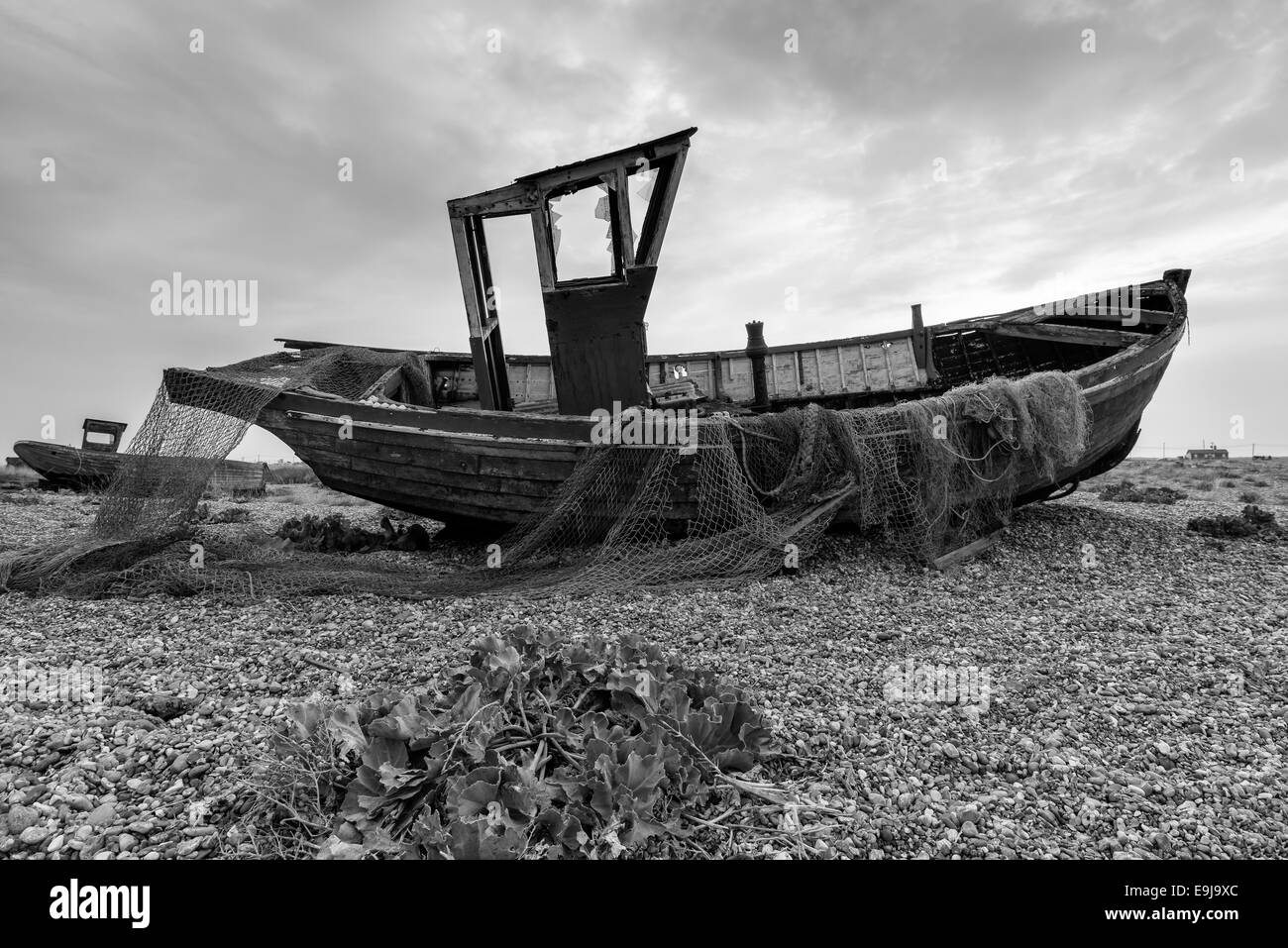 An old fishing boat with nets in black and white stock for Old fishing boat