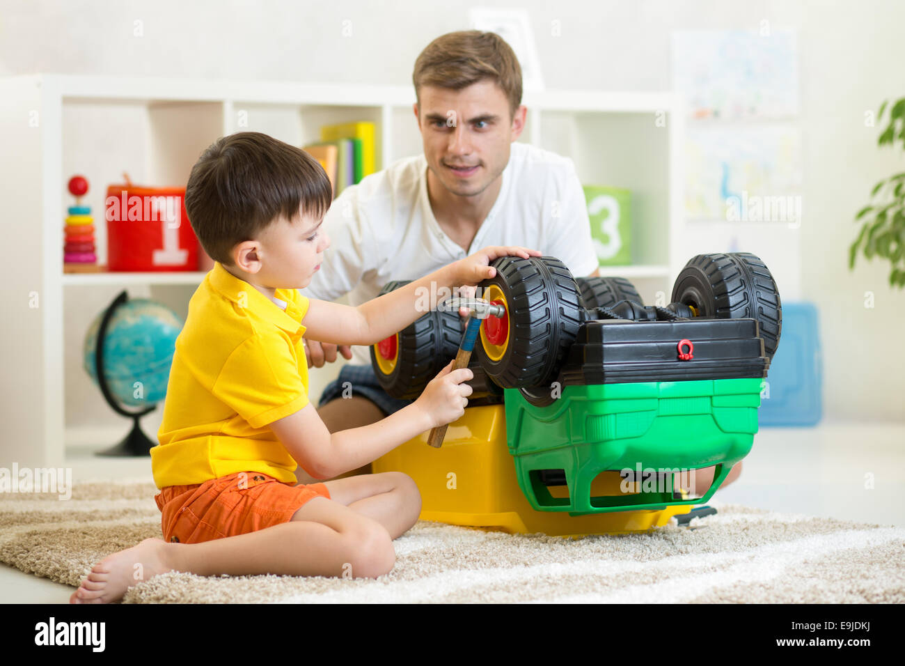 Boy Toys For Dads : Child boy and his father repair toy car stock photo
