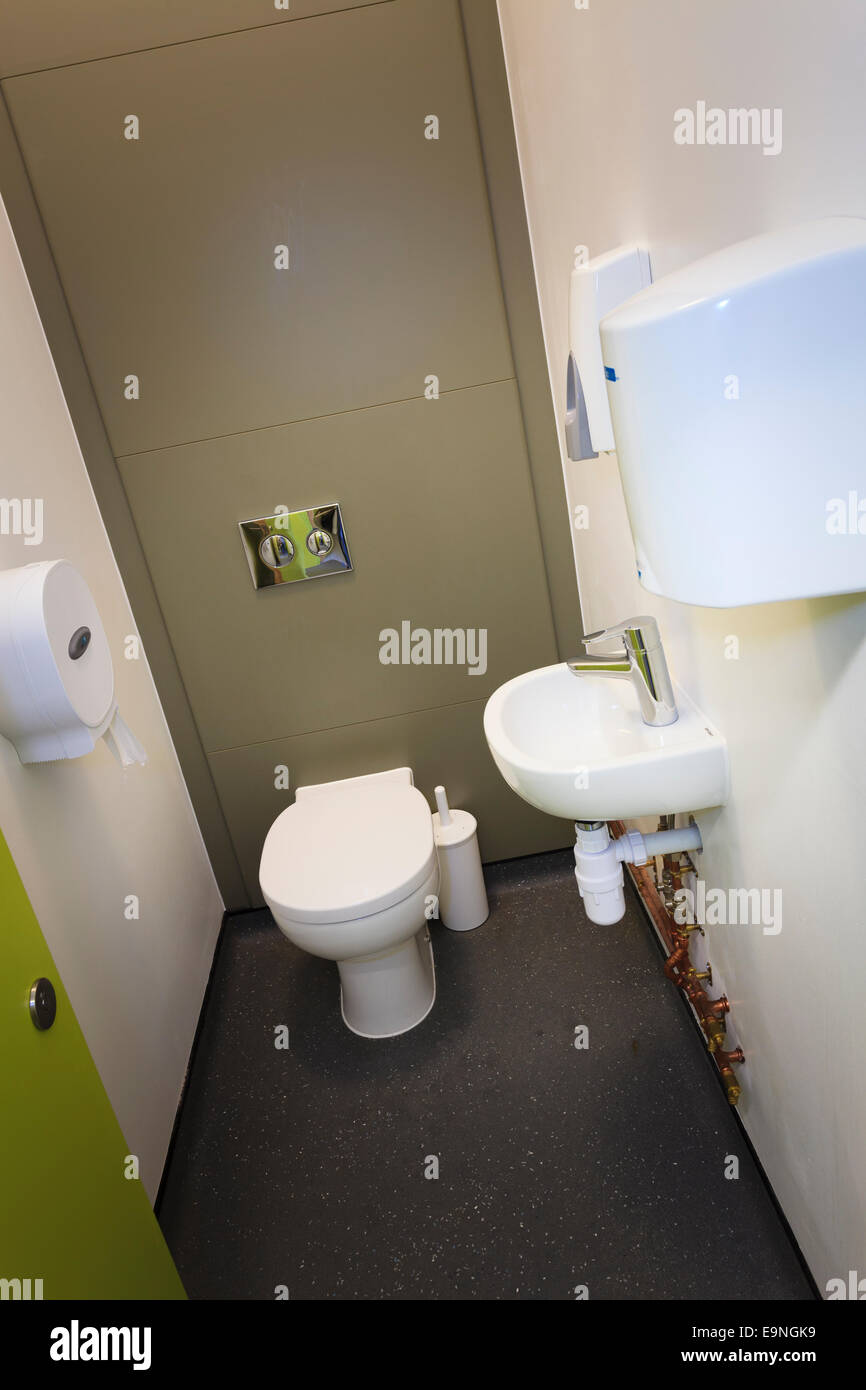 Individual toilet cubicle with wash hand basin Stock Photo ...