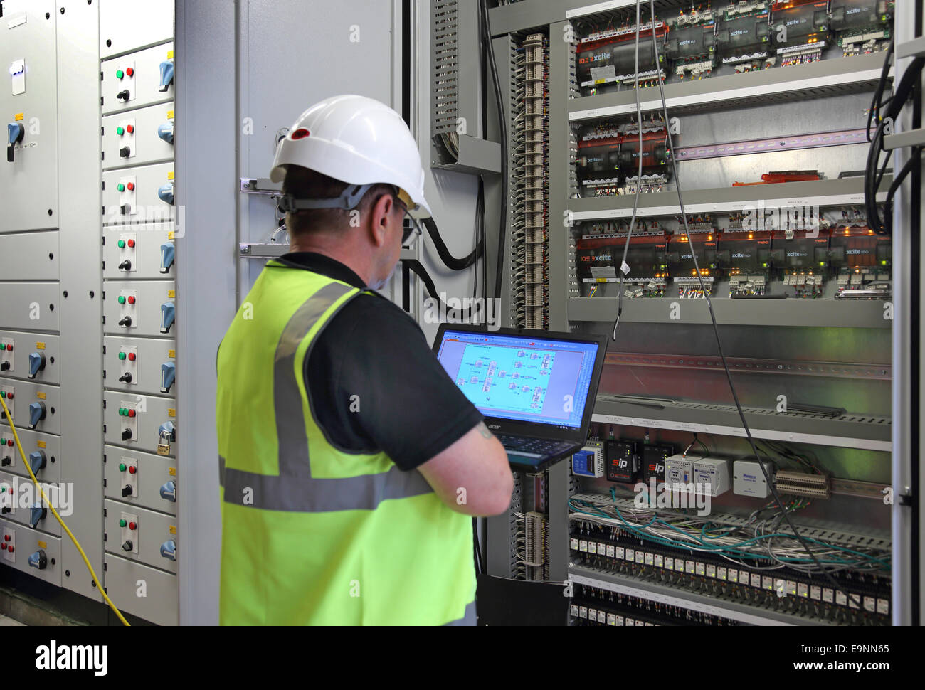 Electrical Engineer Equipment : A building services engineer monitors equipment in an