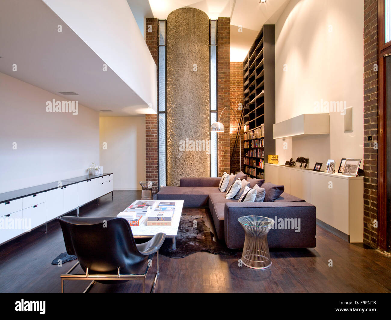 Open plan double height living room in barbican apartment london uk