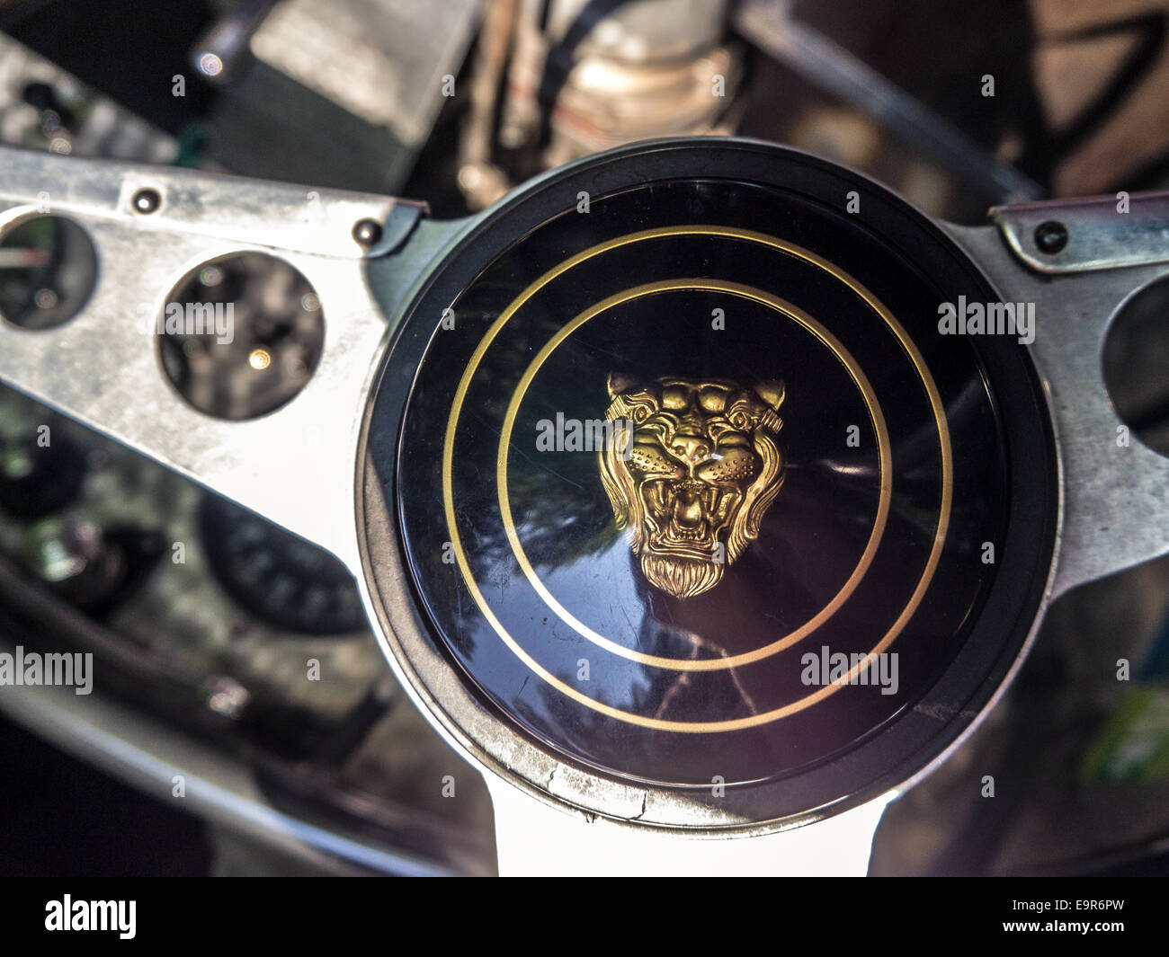 A black jaguar sports car stock photos a black jaguar sports car a classic jaguar logo on a racing car steering wheel stock image biocorpaavc Gallery