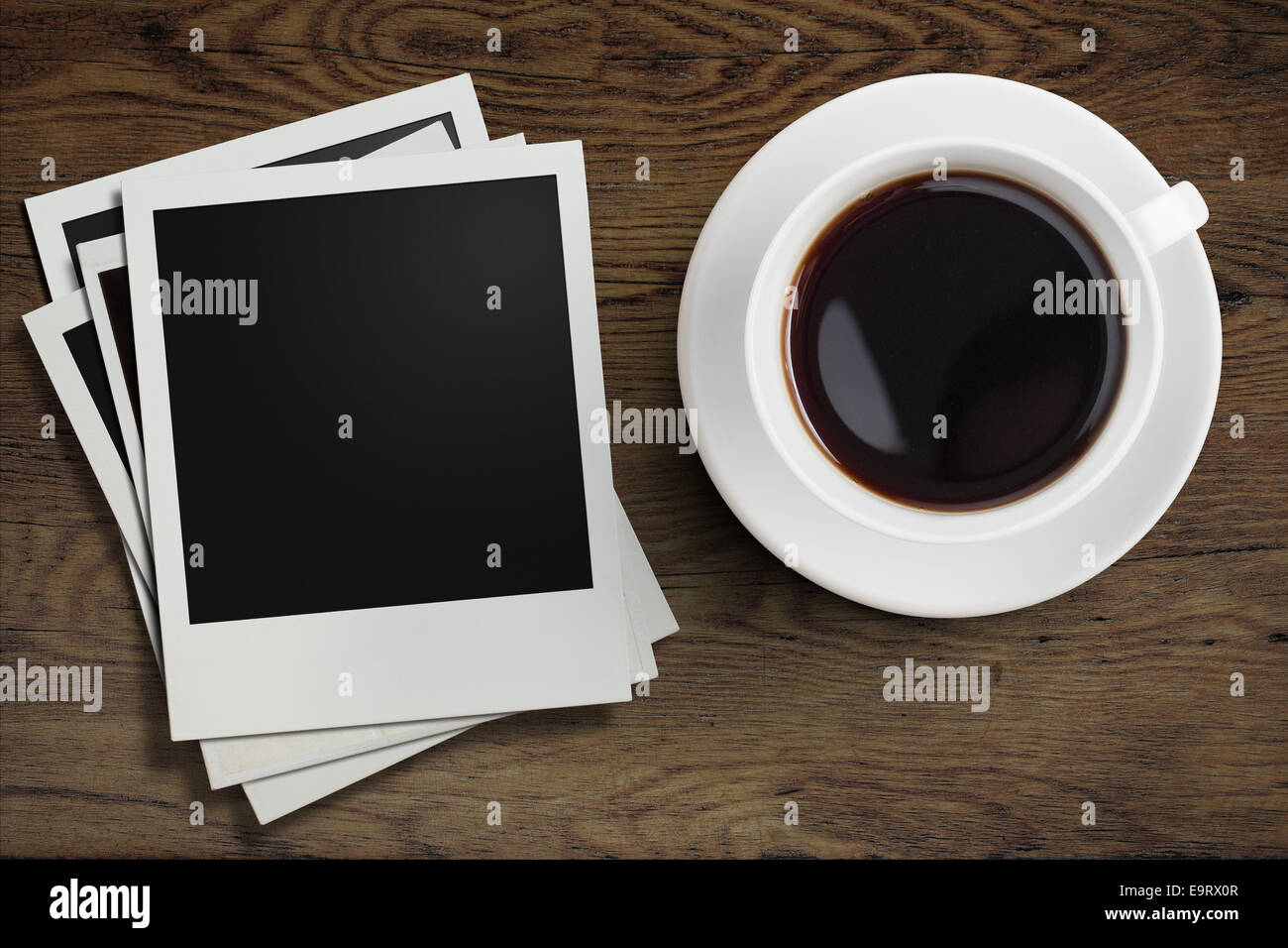 Coffee cup frames - Stock Photo Coffee Cup And Polaroid Photo Frames On Wooden Table Top View