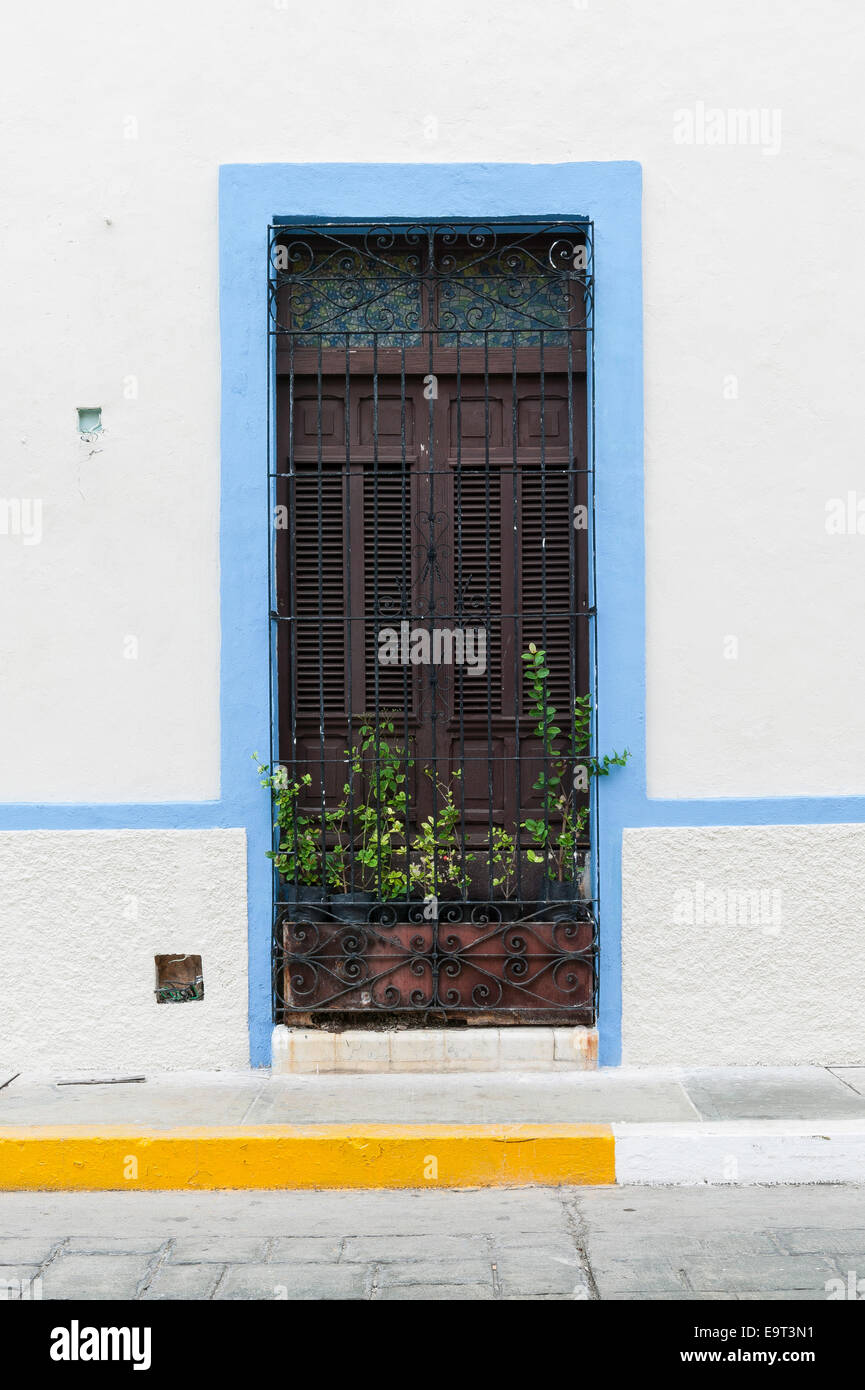 white spanish colonial house window trimmed in light blue. Black Bedroom Furniture Sets. Home Design Ideas