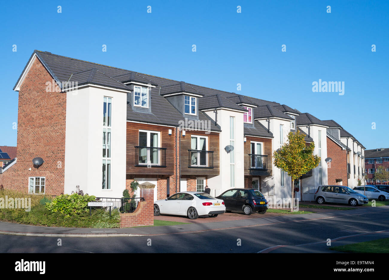 Modern three storey terraced houses in washington north for Modern new homes uk