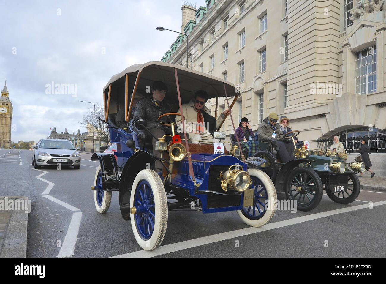 London, UK. 02nd Nov, 2014. Vintage cars driving through London ...