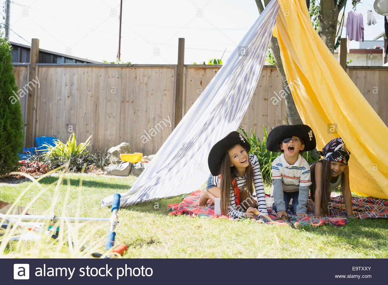 children playing pirates in backyard fort stock photo royalty