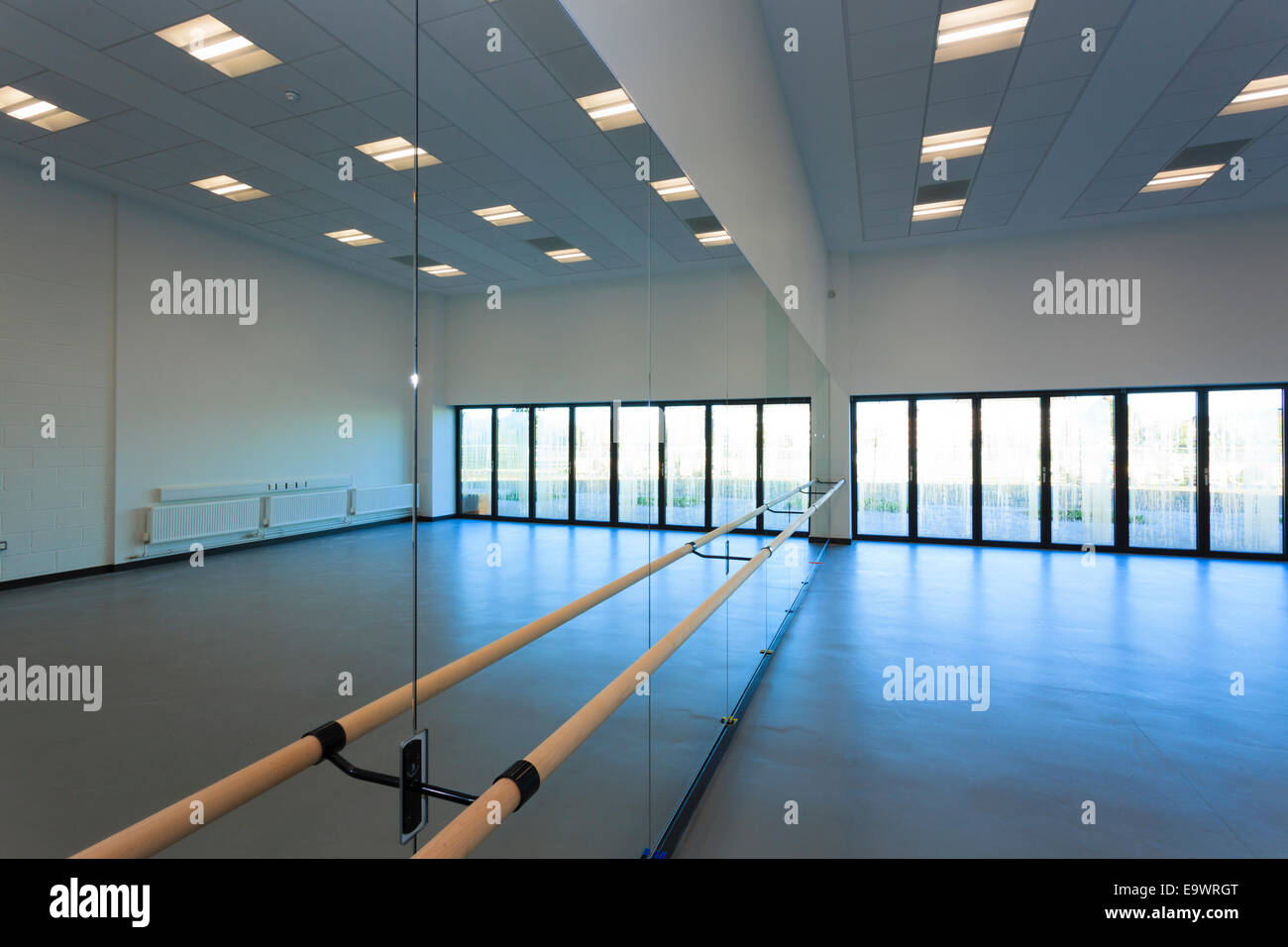 unoccupied dance studio with mirrors and ballet barre