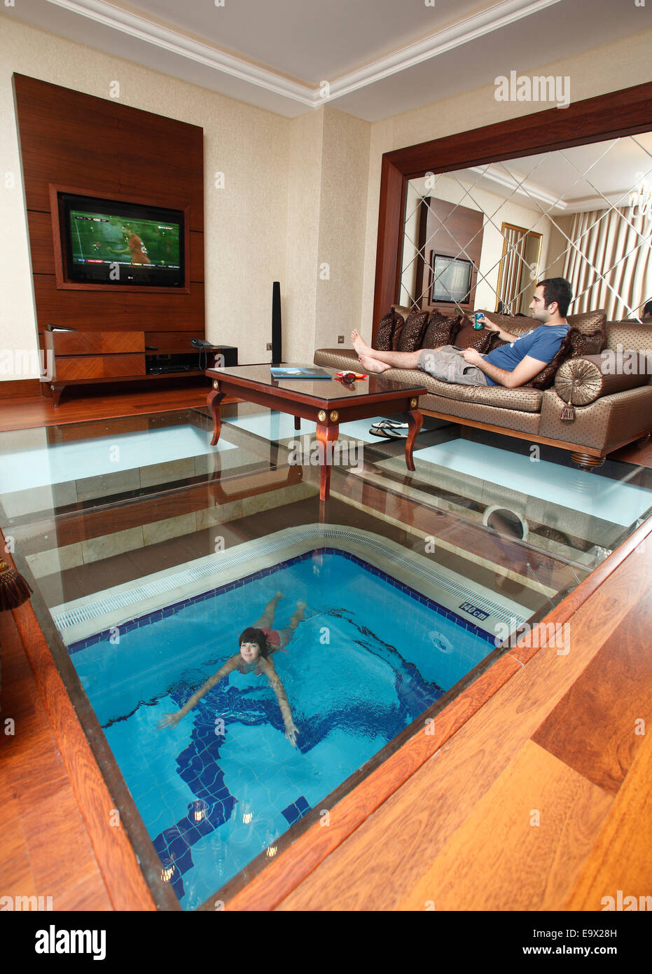 Indoor pool villa  Young couple in a villa with indoor pool,Gueral Premier Resorts in ...